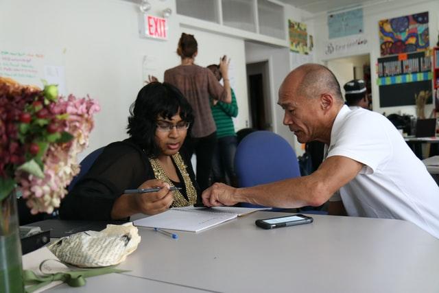 Man mentoring young woman
